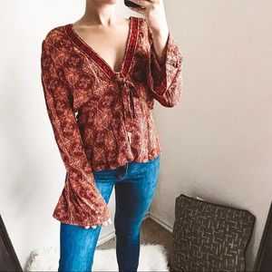 free people - printed v-neck blouse bell sleeves